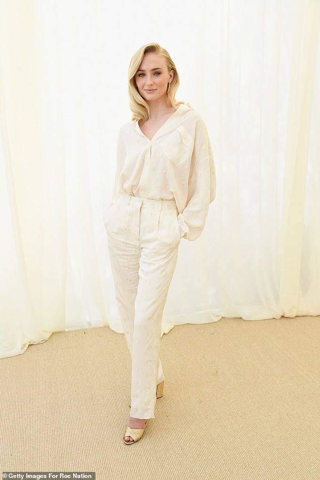 Dressed to kill:Sophie was the acme of brunch chic, modeling a slightly sheer off-white blouse with matching high-waisted slacks and a pale yellow shoe