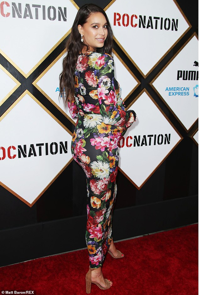 Strike a pose: April draped her baby bump in a floral full-sleeved dress, letting the cameras catch sight of multiple angles as she posed on the red carpet