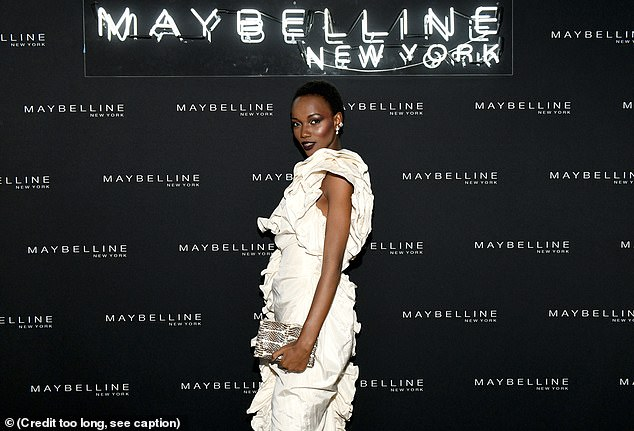 Aglow: Herieth, who was born in Tanzania, flashed one of her enviably trim legs through her gown's dangerously high thigh-slit as she posed for the shutterbugs