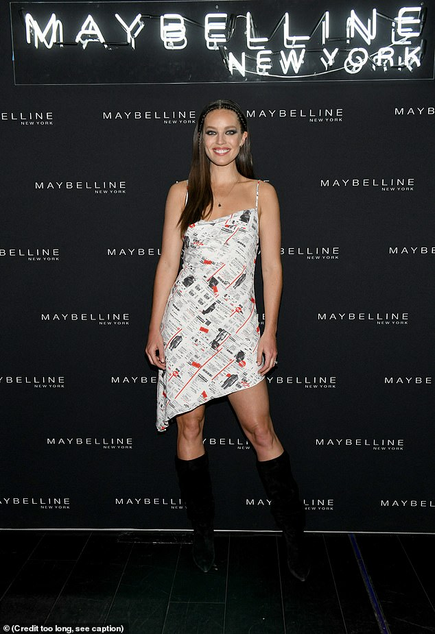 Kooky:Emily DiDonato slid into a funky Miaou cocktail dress with a receipt print design and a slanted hem, slipping into platform boots that went nearly to the knee