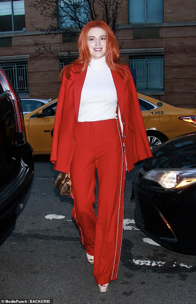 Turning heads: Bella Thorne made quite the entrance in a red power suit at the Jonathan Simkhai show during New York Fashion Week on Saturday