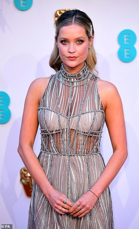 Semi-sheer: Laura flashed a hint of her midriff, her unique gown featuring a halterneck design at the top of the dress
