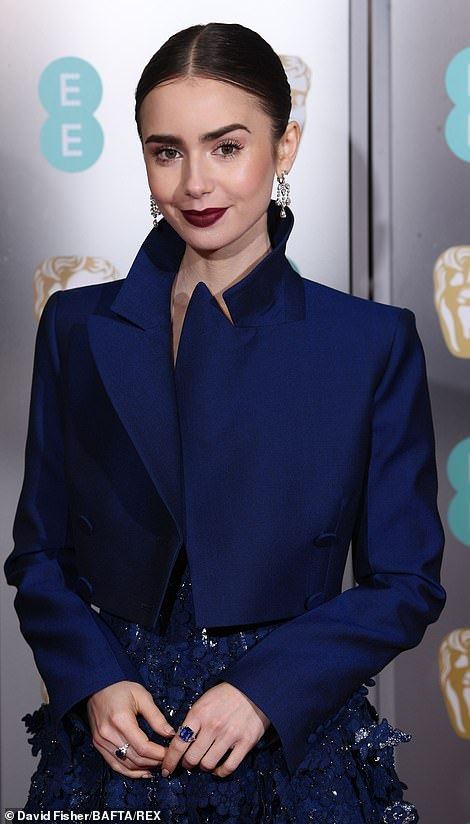 Gorgeous: The on-screen sensation made the most of her striking porcelain features as she slicked back her brunette locks into a tight bun and added a slick of dark lipstick
