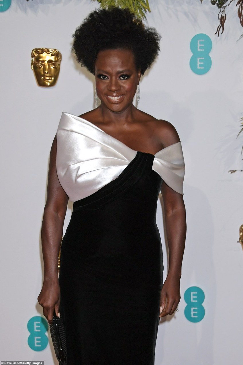 Major star: Viola, who is up for Best Actress in a Leading Role for Steve McQueen's Widows, sported heavy eyeliner, and silver earrings, while toting her essentials in a chic clutch bag