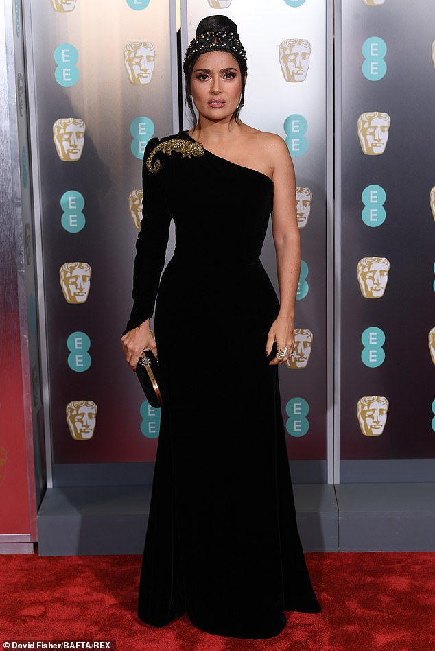 A vision: Salma Hayek proved she is also one of the world's most fashionable women as she graced the red carpet at the 72nd British Academy Film Awards at London 's Royal Albert Hall on Sunday evening