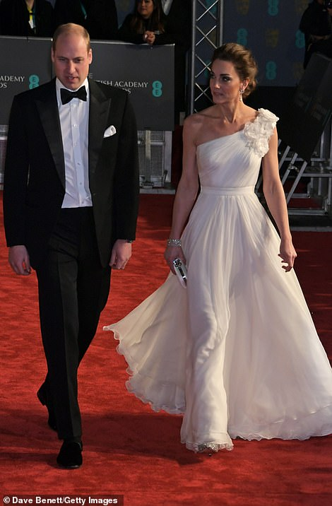 Walk this way: Kate added to the regal red carpet look in a pair of Jimmy Choo heels