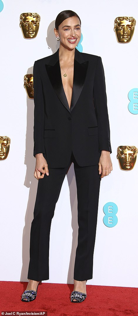 Sartorially savvy: She completed her look with a pair of embellished heels and opted for silver hoop earrings to match her simple gold necklace