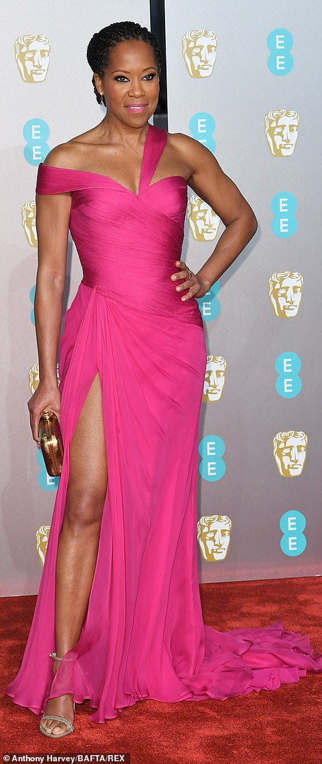 Smokin' hot: Regina King proved to be flawless in a hot pink number which flattered her figure to perfection