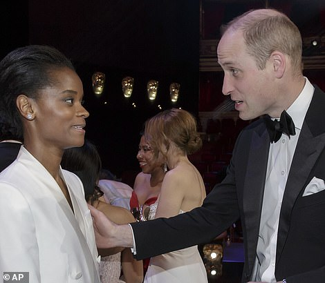 Mingling: Prince William was seen congratulating EE Rising Star winner Letitia Wright while Kate delightedly shook hands with Olivia