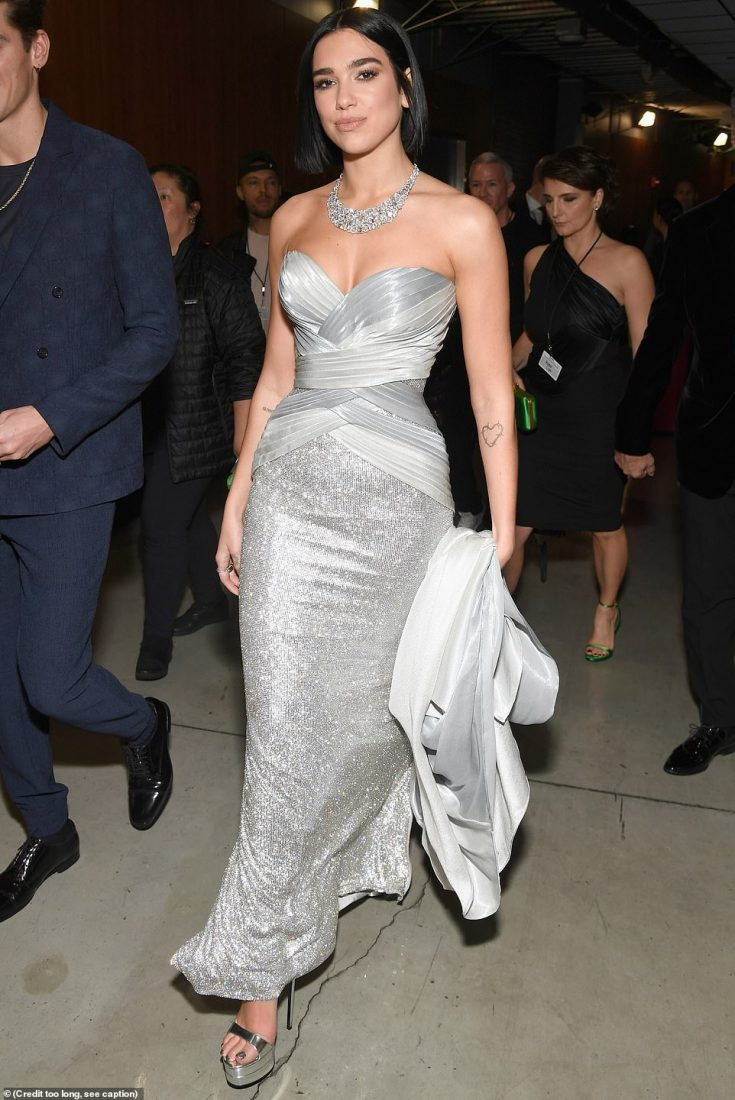 Versace vixen:Dua Lipa stunned in a silver strapless Vesace gown which was gathered across the bust and hips elegant