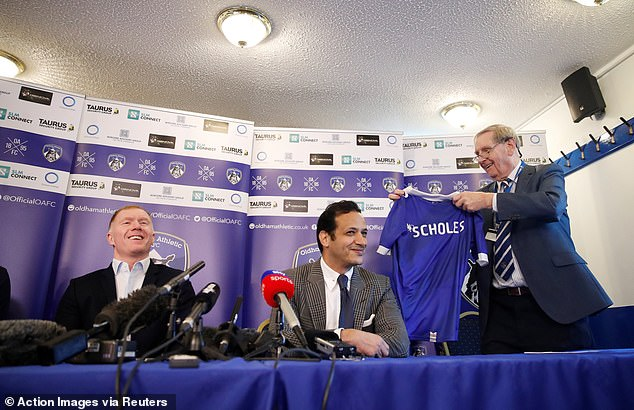 The new boss was presented with a Latics shirt with his name on it at his unveiling