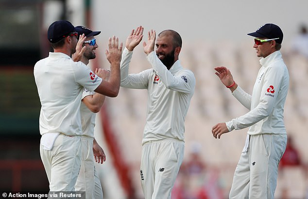 Moeen Ali celebrates with Jimmy Anderson after taking three wickets on day four
