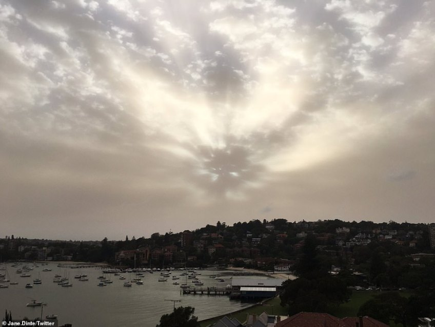 The dust (pictured over Sydney on Wednesday) blew eastwards, engulfing Canberra on Tuesday evening and reaching Sydney overnight