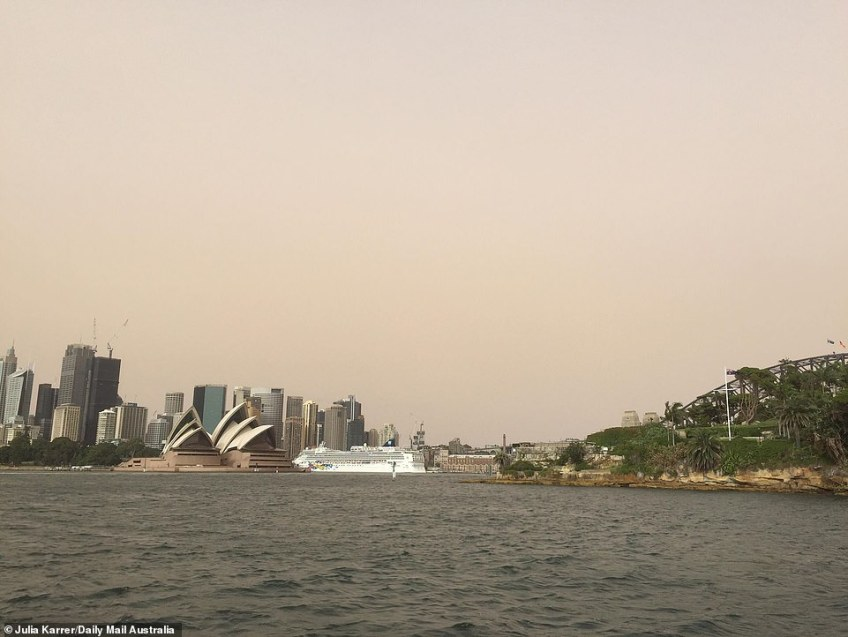 Perth will be 33C and sunny with a possible shower in the evening while Adelaide will be 22C and partly cloudy. Pictured: Dust over Sydney on Wednesday