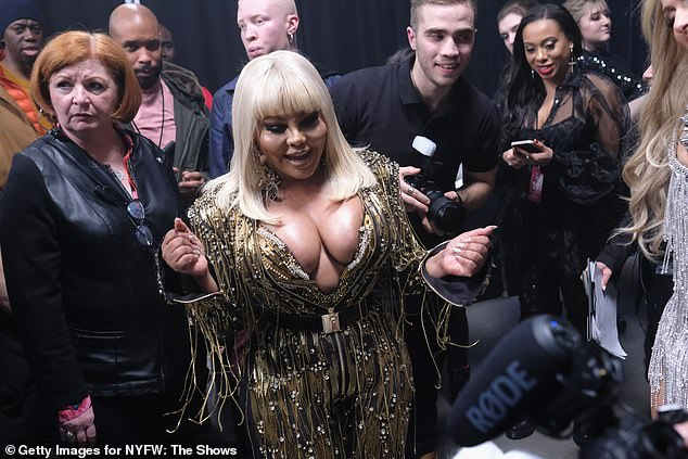 Centre stage: Lil' Kim, born Kimberly Denise Jones, looked absolutely incredible