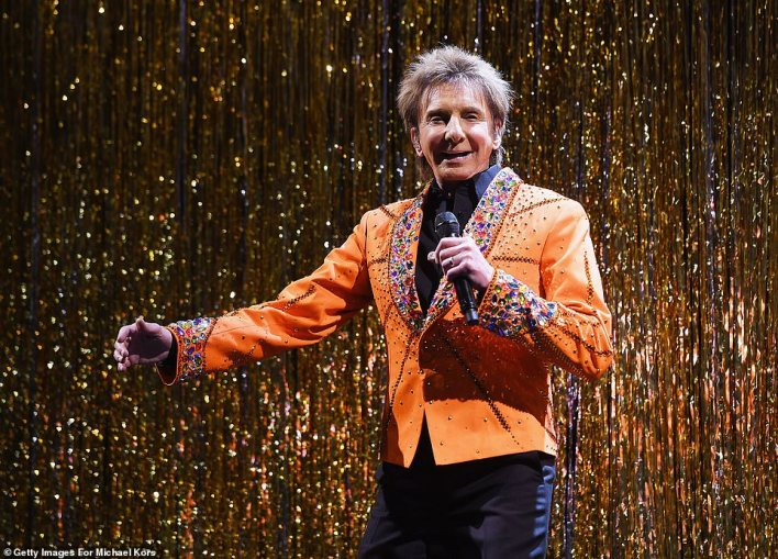 He's still got it!As if the runway stars weren't enough showcase the upcoming range, Barry Manilow performed at the fashion event