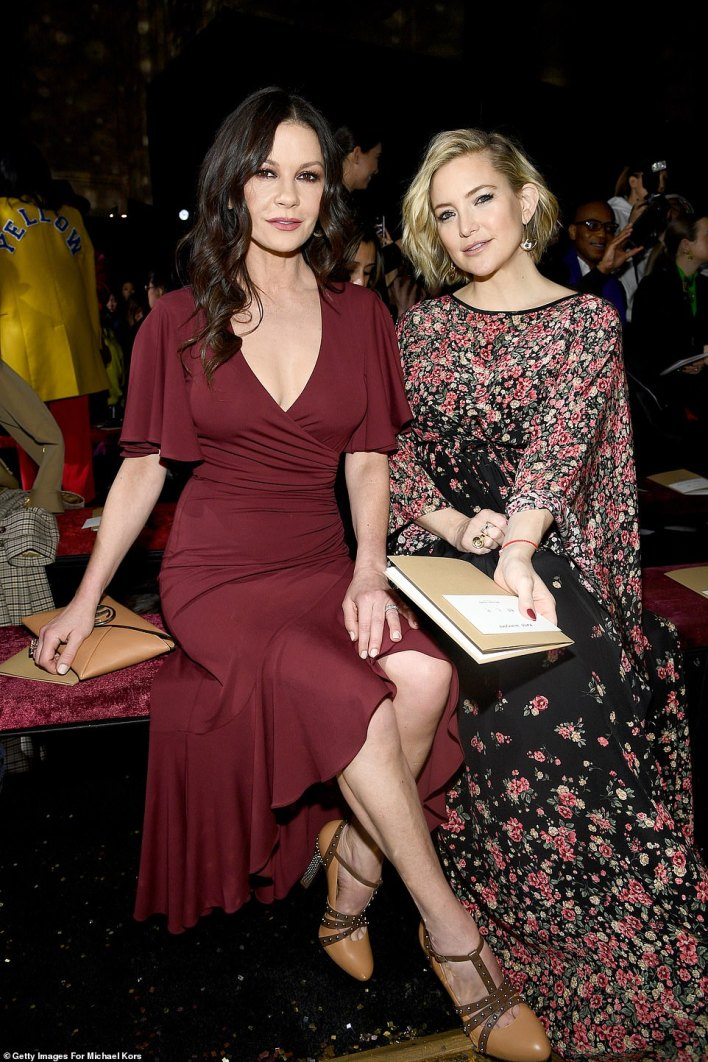 Wow: Catherine posed next to Kate while seated in the front row