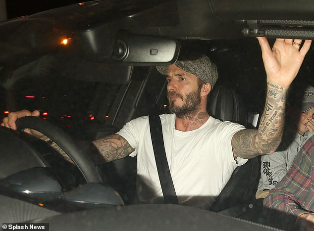 Beckham (pictured above) was caught in front of the camera during the phone conversation while driving in London