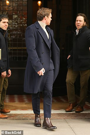 Best foot forward:Richard stepped out in pair of smart chestnut boots