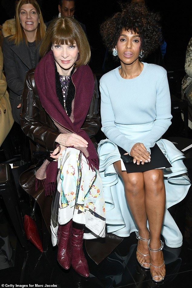 Double trouble:Kerry enjoyed a front row seat to the show alongside Vogue editor-in-chief Anna Wintour, who was wrapped up warm in a glossy leather jacket, playful skirt, and crocodile print ankle boots
