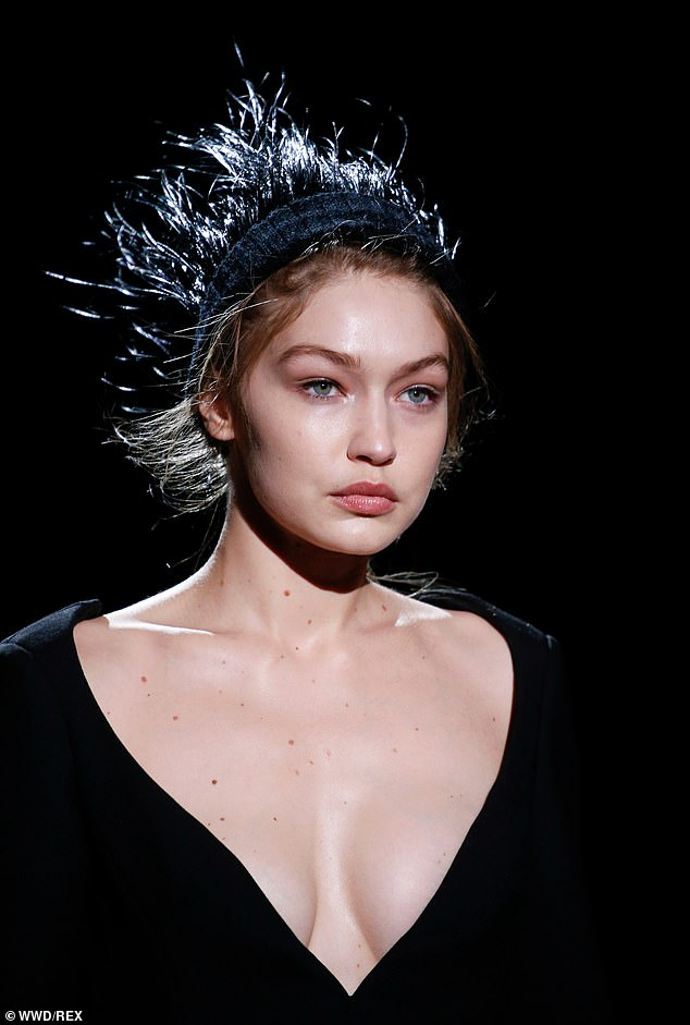 Hair story:Her trademark sandy blonde tresses were swept off her face as they were held in place by a black couture headband