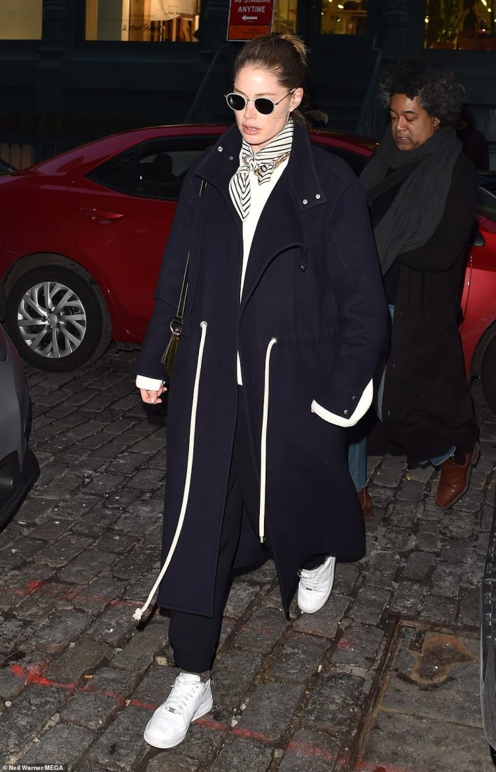 Another one: She swapped the look out for a chic navy and white calf-length coat