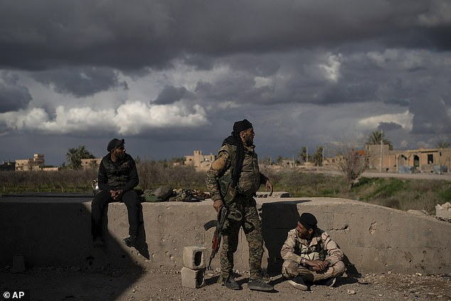 US-supported Syrian Democratic forces fighters (SDFs) are in an area they recently captured by ISIS while the fight against the terrorist group continues in Baghouz