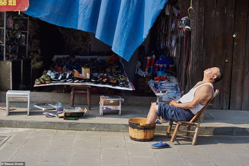 As part of his portfolio submission, Urwin took this photo of a shoe salesman taking a break in the sunshine and soaking his feet in a wooden bucket