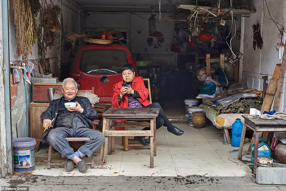 This image by Urwin shows a man named Qingyuan Xu sitting outside his makeshift 'doctor's surgery' where he practices traditional medicine. Giving some background to the doctor's story, Urwin says: 'Qingyuan, 78, began studying traditional medicine at the age of eight under the tutelage of Master Liu, one of the physicians to Chiang Kai-shek, the former Chinese leader who was ousted by the Communists and forced to flee to Taiwan'
