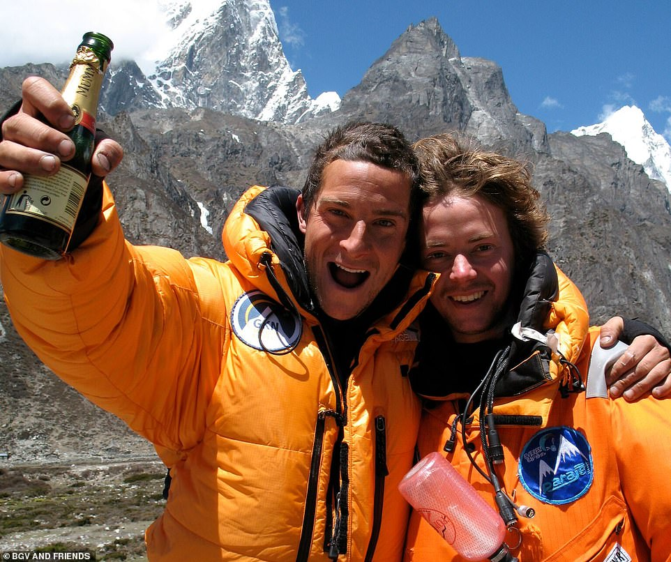 Bear seen celebrating with his best friend Gilo Cardozo after their quirky paramotoring flight above Everest. The thrill-seeker said: 'This photo is special to me. It marked the end of a high-risk endeavour that could so easily have gone wrong. Gilo was the true hero, having designed and built the most powerful paramotor to that date'