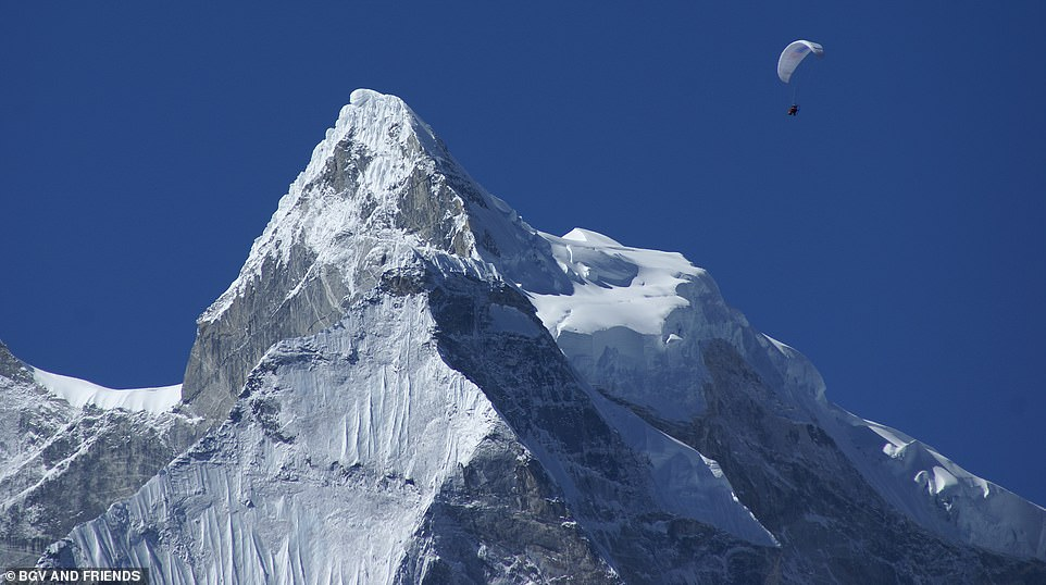 Daredevil: In this photo, taken in 2007, Bear is seen paramotoring over Everest under cloudless blue skies