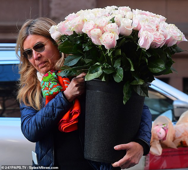 Special delivery! A huge bucket of pink roses was seen being delivered to The Mark hotel on Tuesday afternoon ahead of Meghan's shower, sparking rumors she is expecting a baby girl