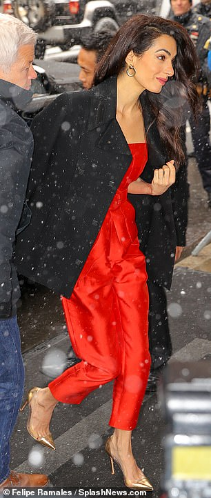 Pink adjacent?Amal Clooney stood out in a red jumpsuit and gold heels