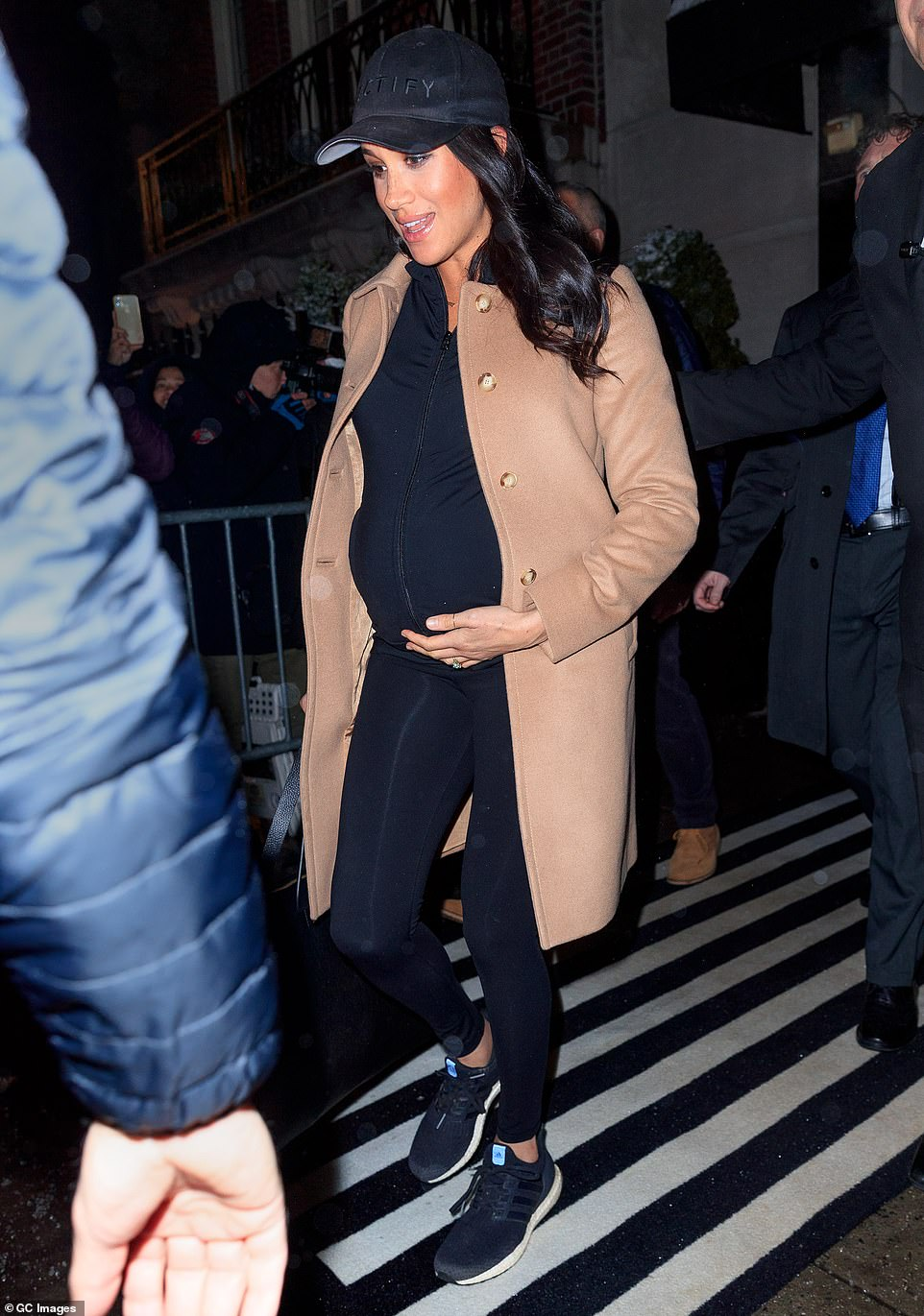 Getting closer! Meghan's large baby bump was clearly visible in the tight top as she left the hotel, having worn baggier outfit options for the much of her $500,000 trip to New York