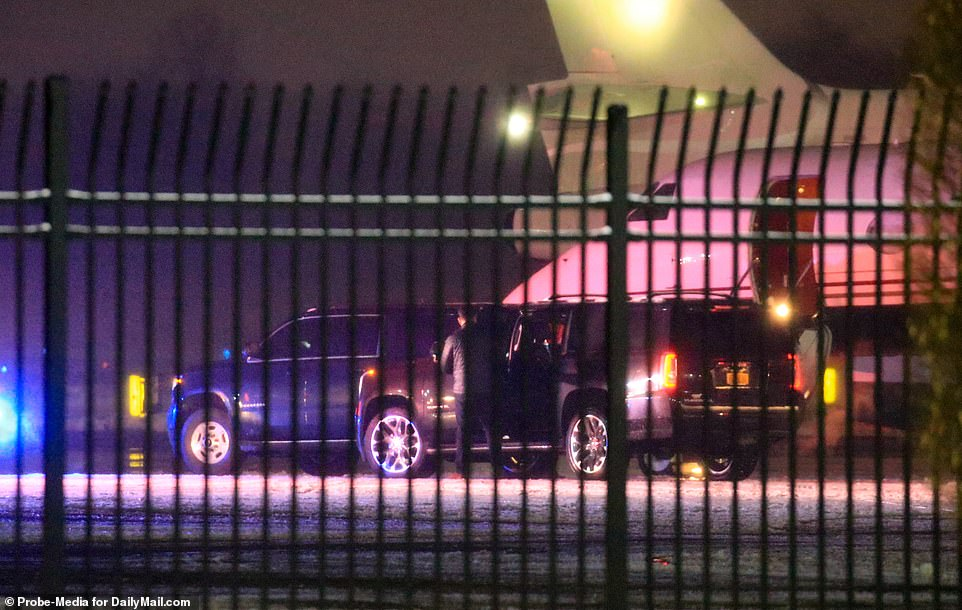 Waiting: Two black SUVs pulled up alongside the plane, with several men dressed in all black emerging from the vehicles before Meghan made her way out of the second car, seen to the right with a door open