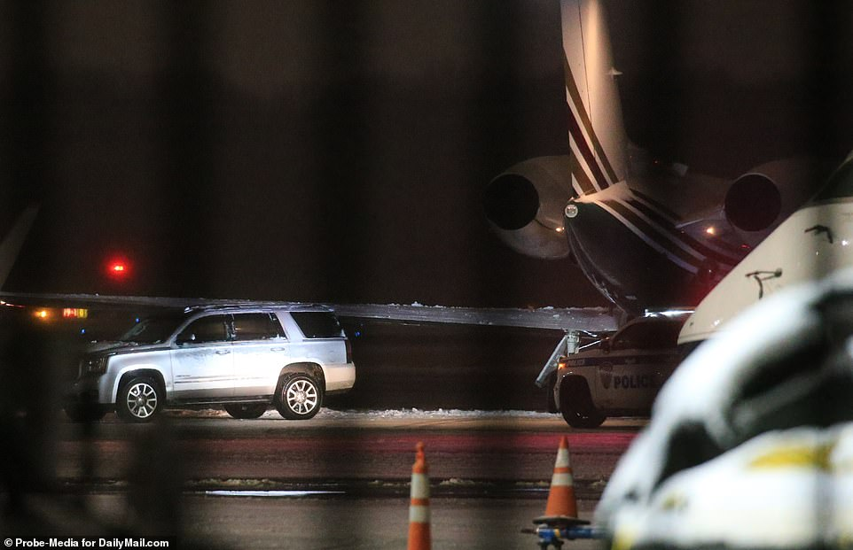 Loading it up: The silver SUV carrying the luggage (seen left) was pictured parked near the private plane, before Meghan's personal SUV arrived at the airport