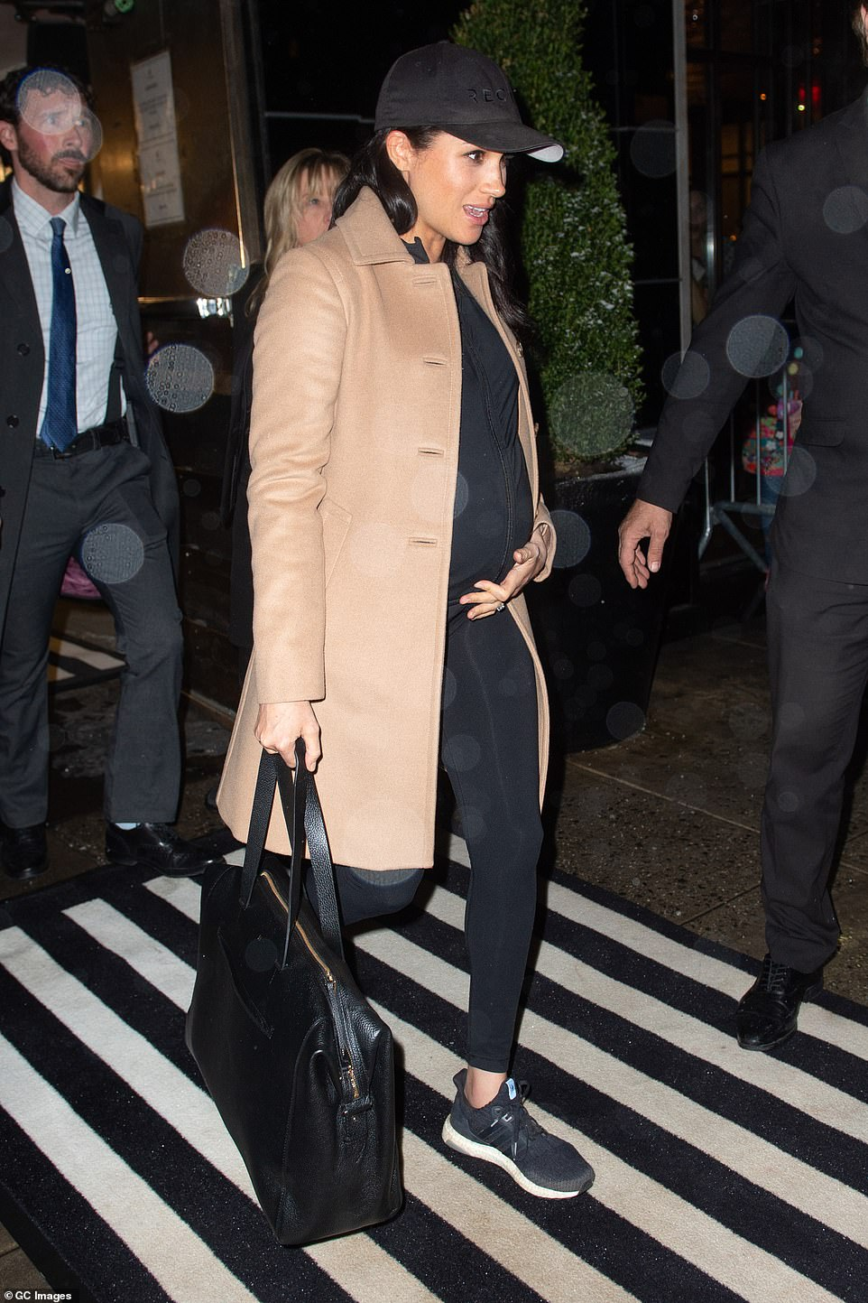 Stylish: The Duchess of Sussex was carrying a $395 leather tote bag from Cuyana, a brand that she is known to favor, and one which her makeup artist Daniel Martin has also partnered with in the past