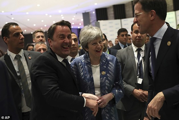 Mrs May speaks with Luxembourg's Prime Minister Xavier Bettel, centre left, and Dutch Prime Minister Mark Rutte, right