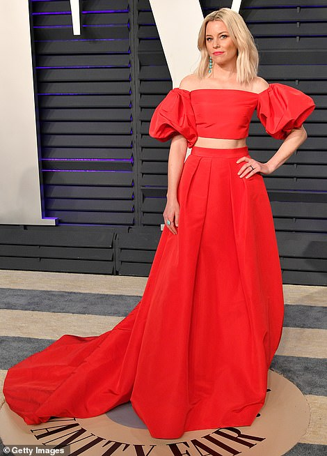 Red alert: Elizabeth Banks showed off her trim tummy in a billowing two-piece gown