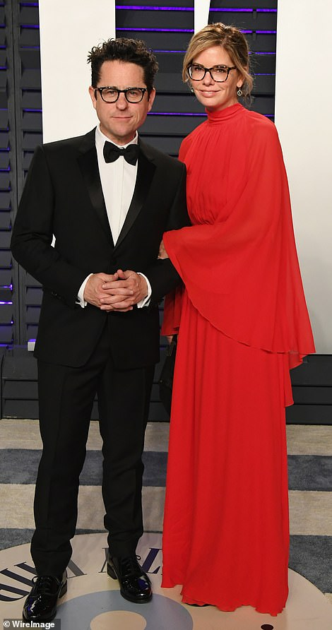 Flowing frocks: J.J. Abrams' wifeKatie McGrath was on the same style page as Vanity Fair editor Radhika Jones (pictured with husband Max Petersen)