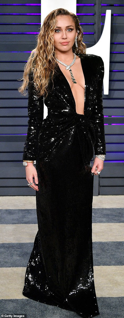 Blonde bombshell: Miley Cyrus took the plunge in a black sequin gown with silver jewelry and wet look locks