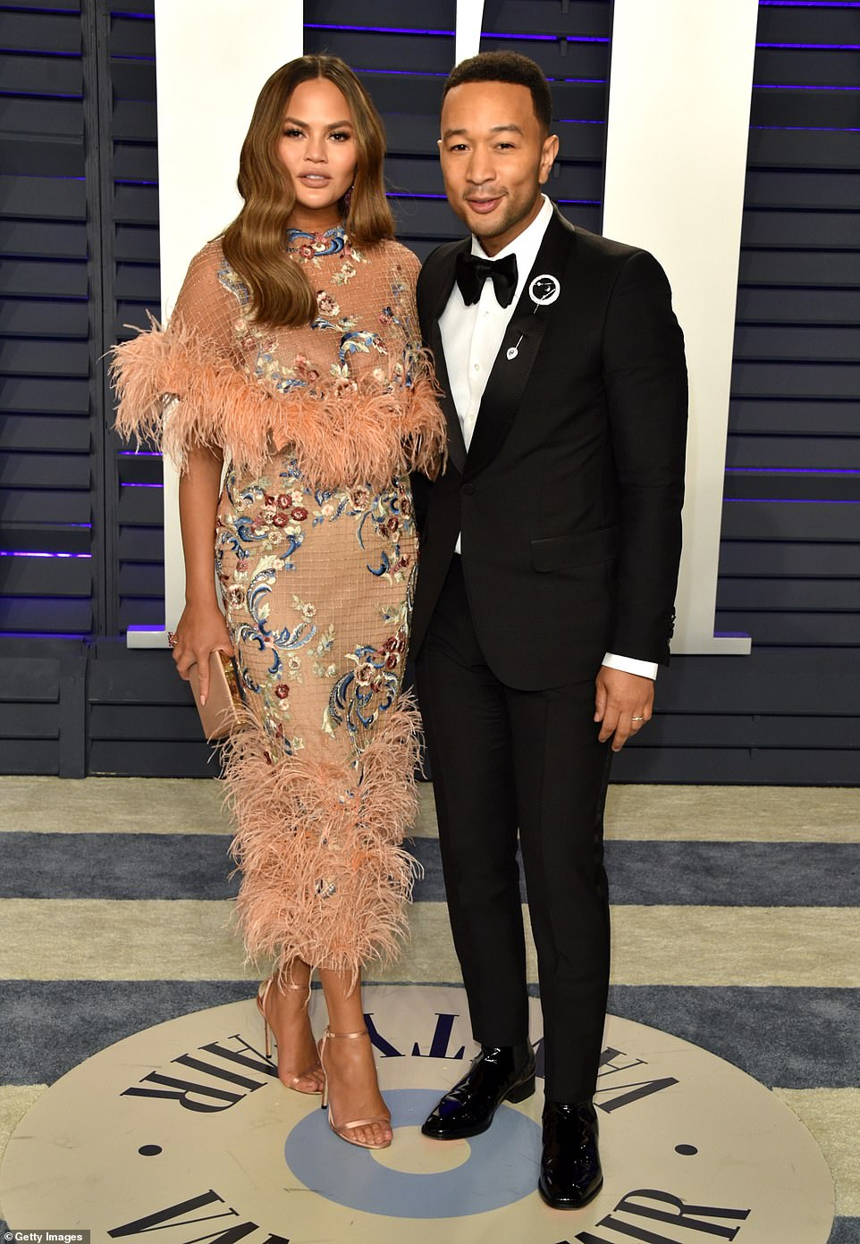 Hot couple: The model beauty was joined by husband John Legend who wore a classic tux