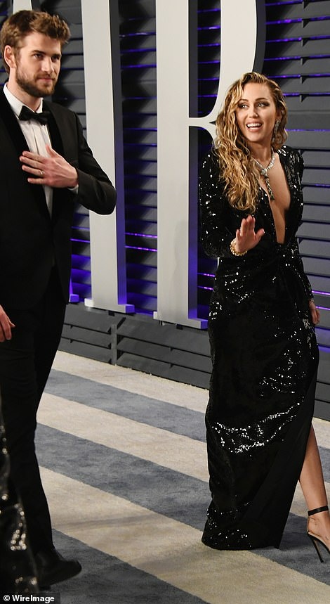 Love: Wherever Miley went, her doting husband was close by her side