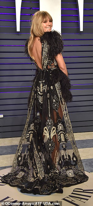 Glamorous:Opting for a quirky yet chic ensemble, the 45-year-old supermodel was dressed to impress as she hit the red carpet at Wallis Annenberg Center for the Performing Arts