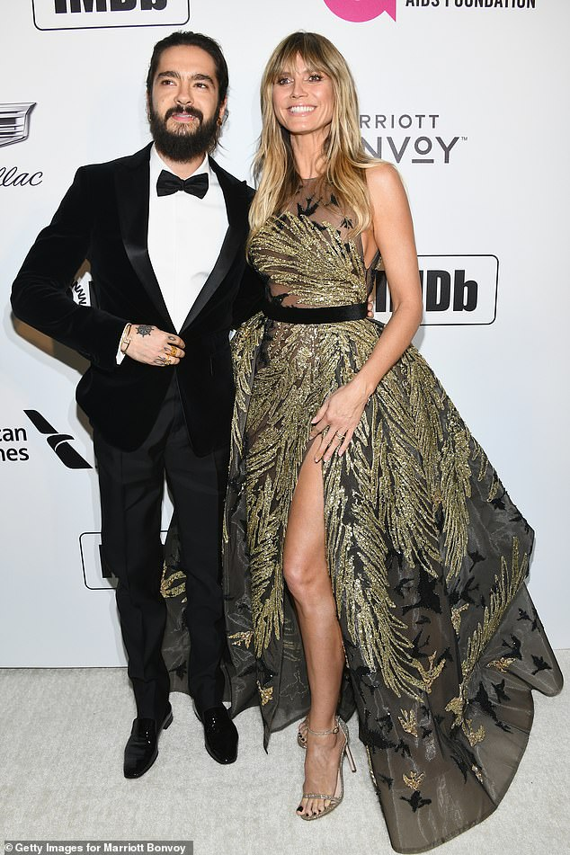 Stunning:Earlier in the night, catwalk queen Heidi was the very definition of glamour as she joined fiance om Kaulitz at the Elton John AIDS Foundation Academy Awards Viewing Party