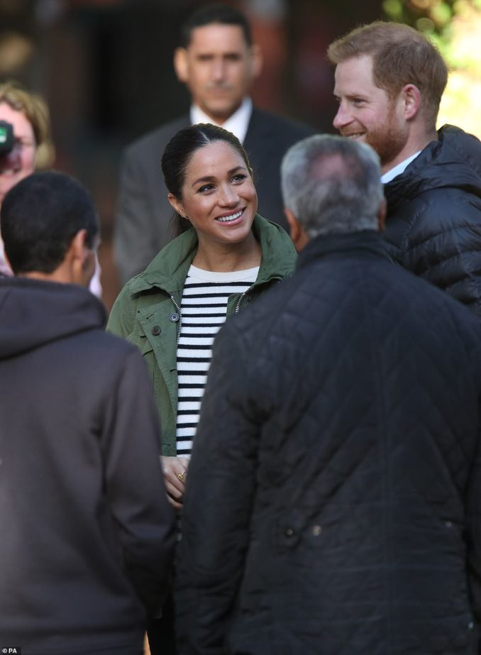 The mother-to-be could be seen gazing at her husband with adoration as he joked with workers on Monday morning