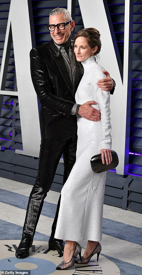 Out there: Jeff wore a sparkly suit, while Emilie wore a sparkling white dress