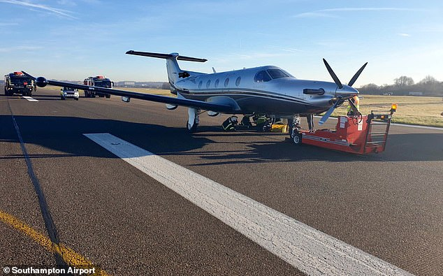 Southampton Airport tweeted a picture of the stranded plane with engineers working under the fuselage after it hada tyre blowout on its front wheel while landing this morning
