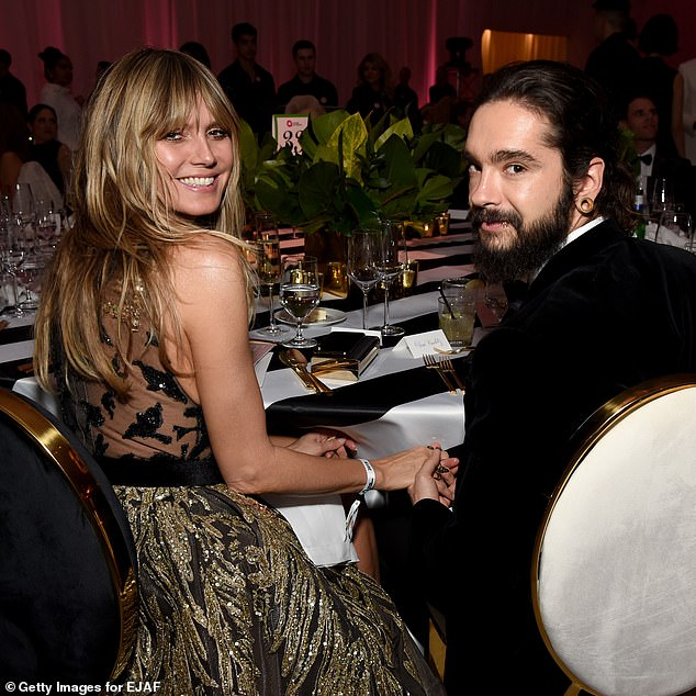Dinner date: Heidi and Tom looked utterly smitten as they sweetly held hands across the table