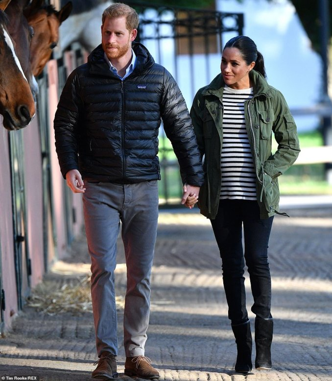 Earlier in the day Meghan dressed down in a Breton t-shirt, black jeans and boots and a J.Crew jacket which has been a favourite of hers since before her royal days